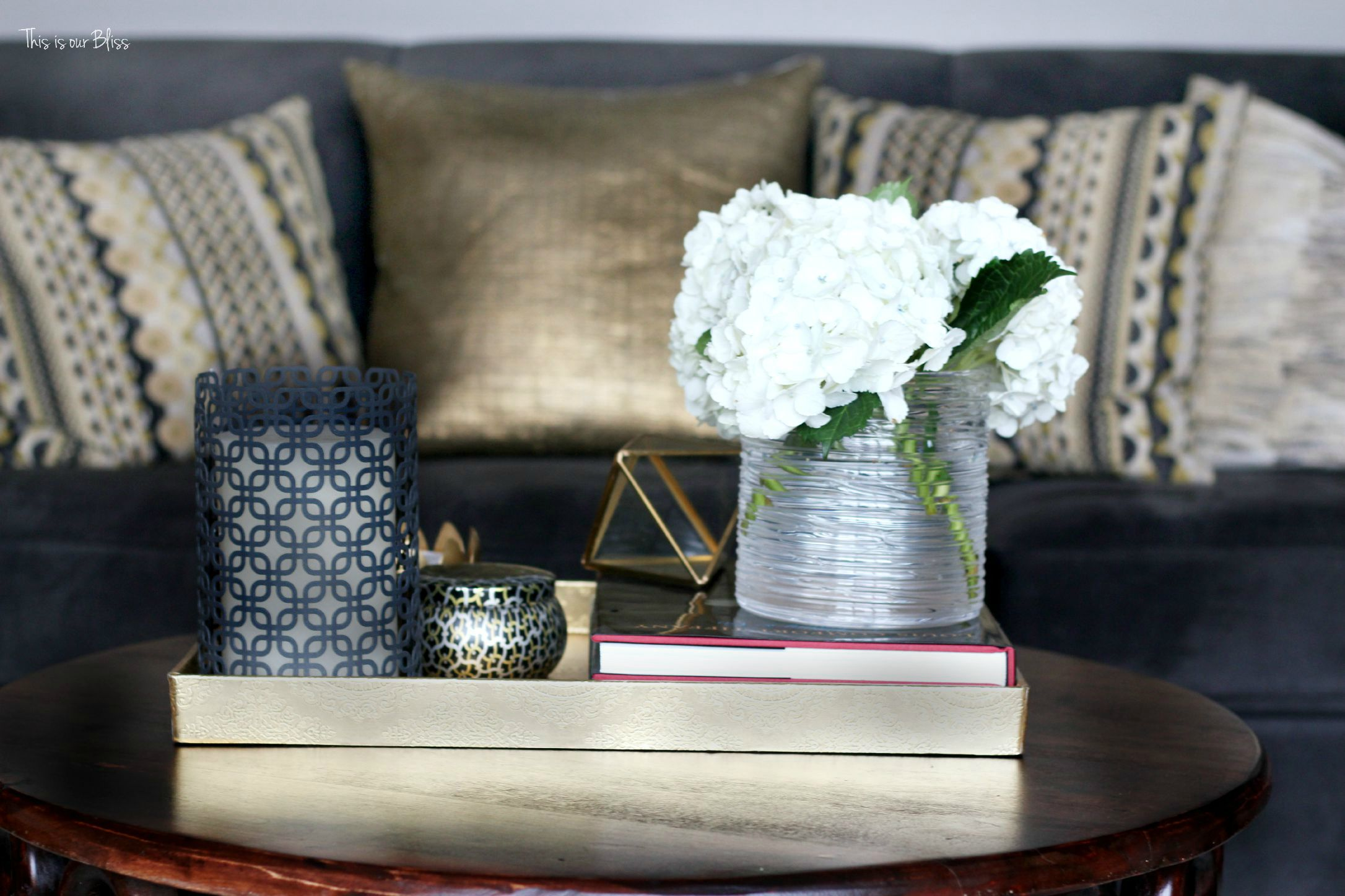 how to style a coffee table - coffee table styling - formal living room couch - gallery wall - elements of a well-styled coffee table 1 - gold detail - back to basics - This is our bliss
