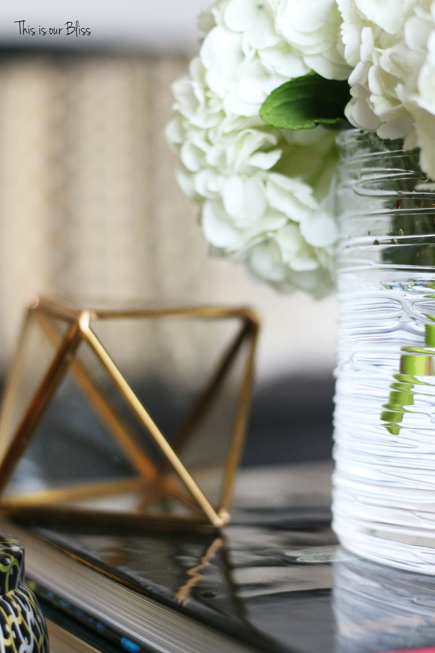 how to style a coffee table - interesting object - living room cofee table styling - This is our Bliss