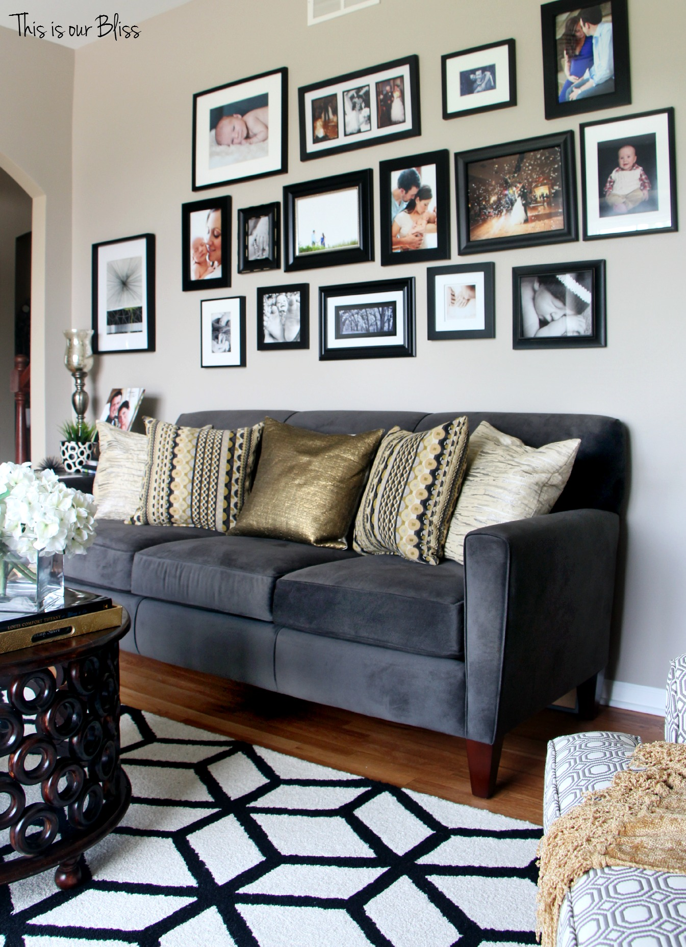 Formal LIving room gallery wall with all black frames This is our Bliss