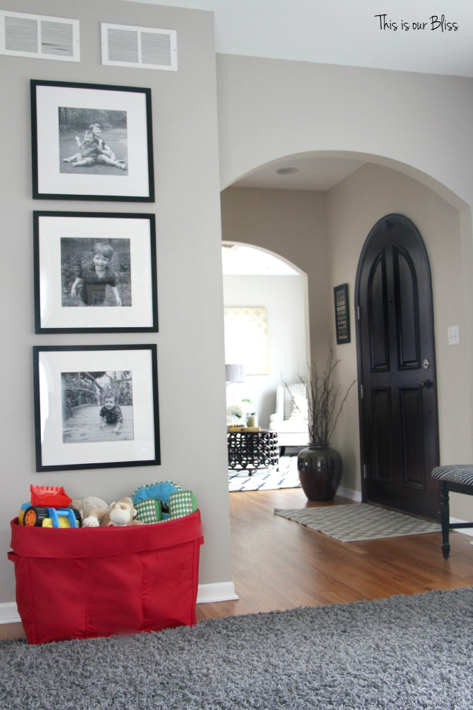 Playroom reading nook playroom gallery wall 3 black frames mini playroom picture wall front door view This is our Bliss