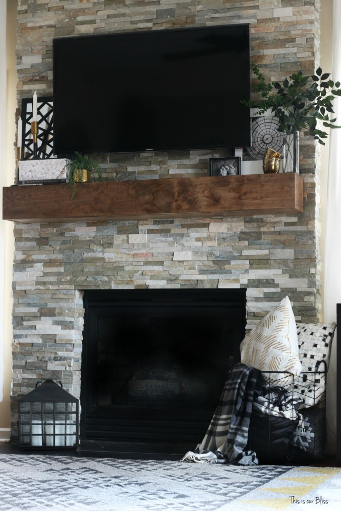 How to style a mantle - black white and gold display on rustic floating mantle - stacked stone This is our Bliss www.thisisourbliss.com