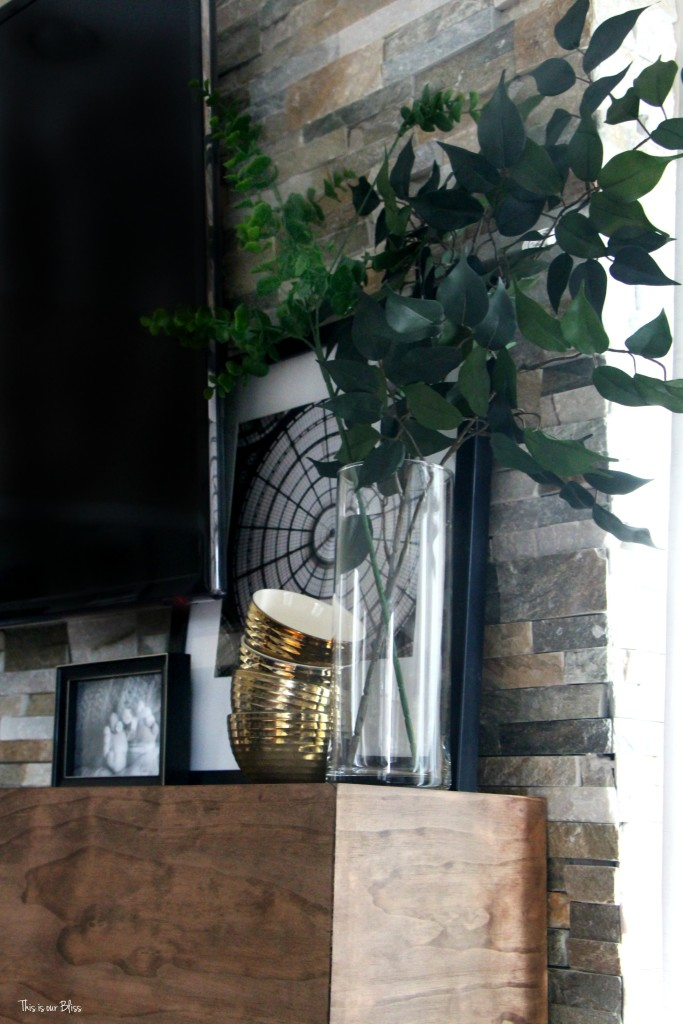 How to style a mantle table top styling hop family room mantle styling layering and leaning with faux stems black white and gold mantle This is our Bliss www.thisisourbliss.com