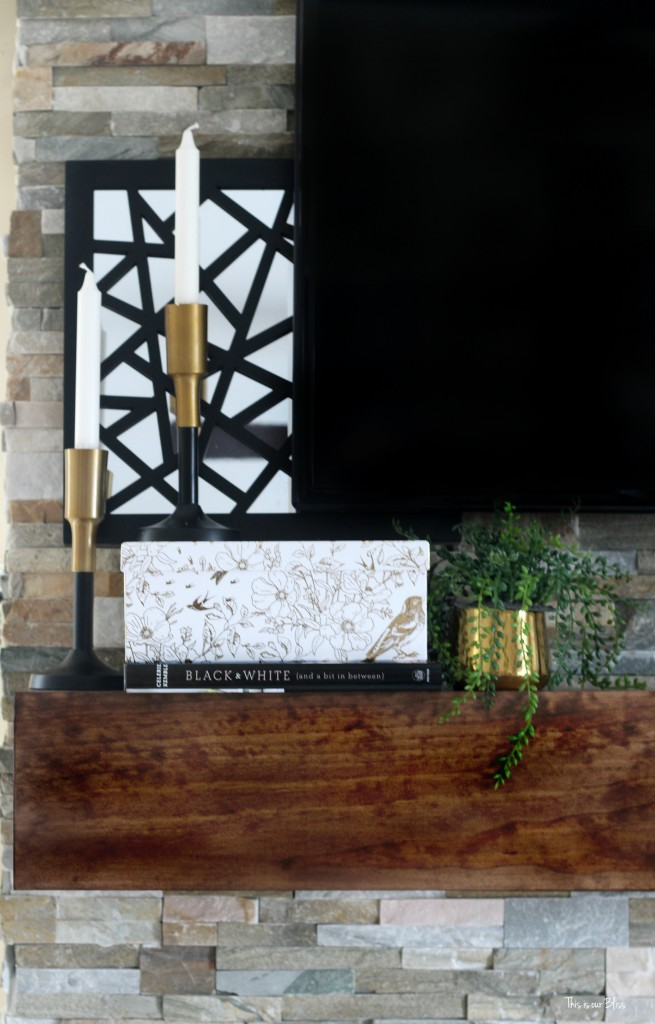 How to style a mantle table top styling hop family room mantle styling stacked books and box black white and gold mantle This is our Bliss www.thisisourbliss.com