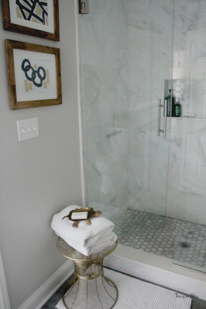 Basement bathroom reveal Marble shower hexagon shower tile   neutral bathroom decor   black, white gold and gray   glam bathroom    This is our Bliss