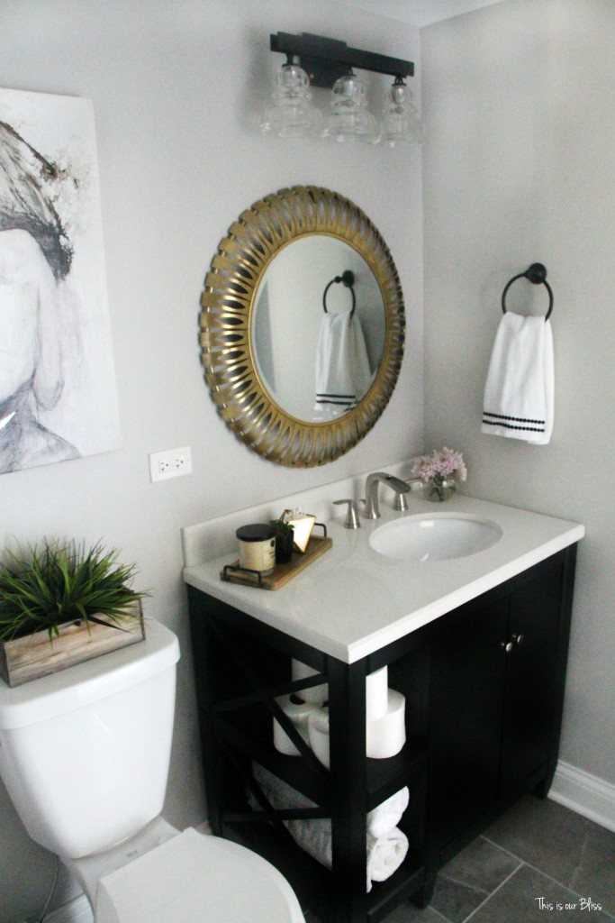 Basement bathroom reveal   gray tile marble neutral bathroom decor black white gold and gray bathroom    This is our Bliss
