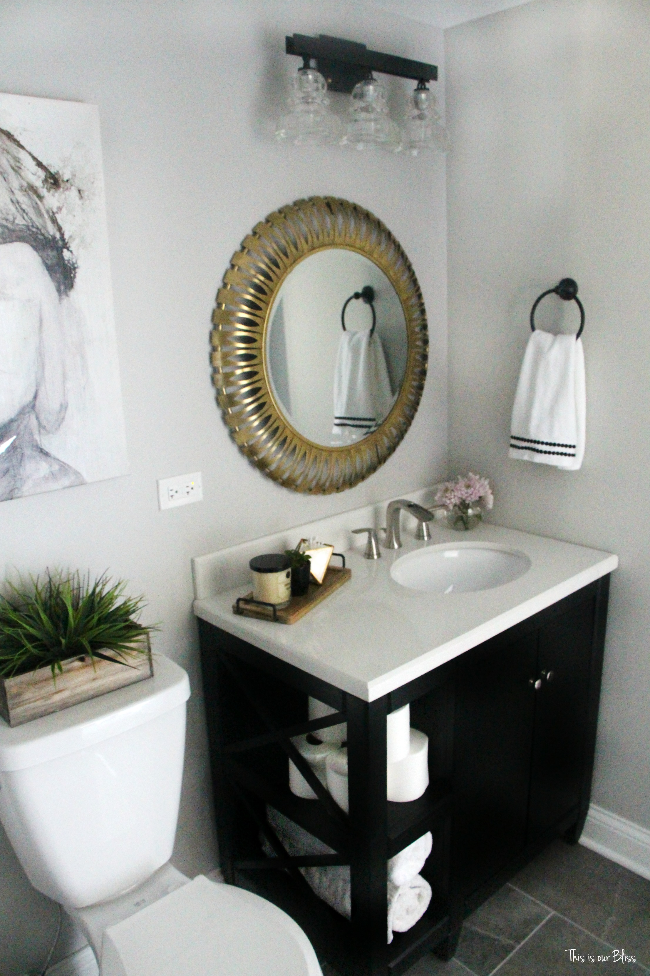 How to create a neutral glam bathroom for Black and gold bathroom accessories