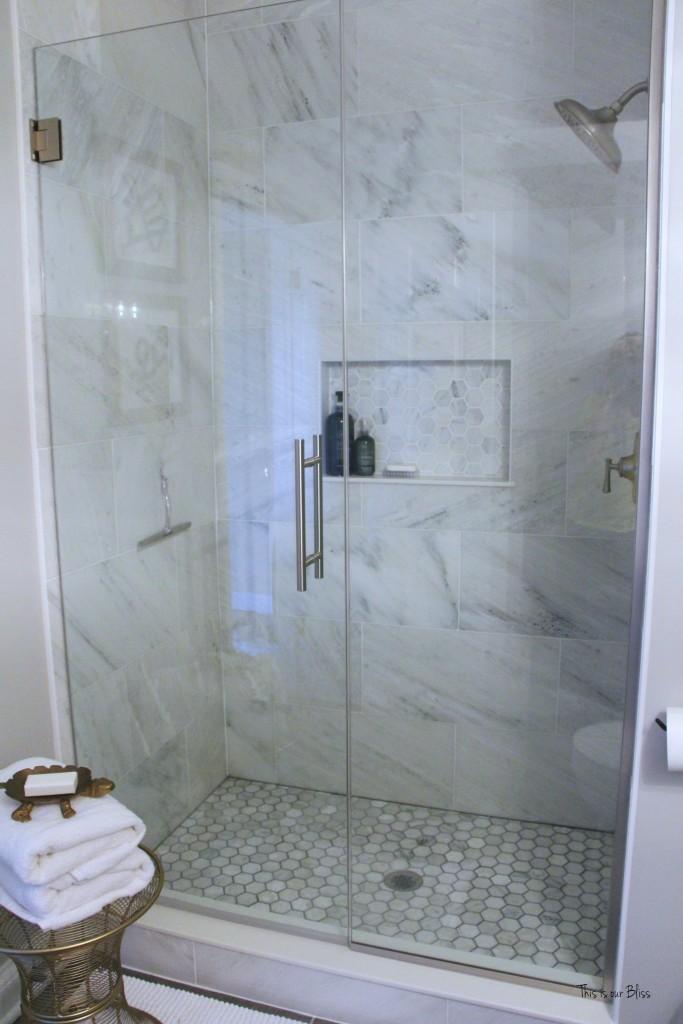 Basement bathroom reveal | neutral glam bathroom decor | marble shower | hexagon tile shower 1 || This is our Bliss