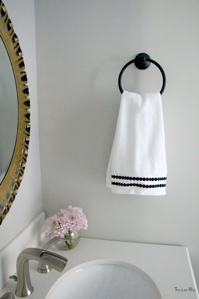 Basement bathroom reveal | neutral bathroom decor black and white gold mirror || This is our Bliss