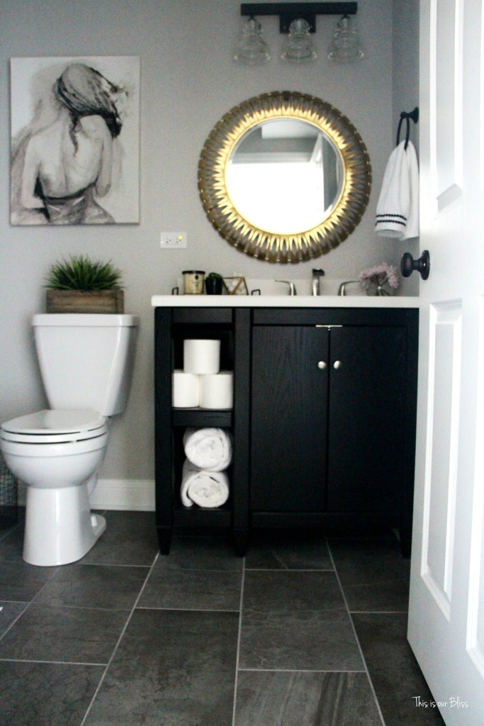 neutral glam bathroom  bathroom decor   marble shower black vanity gold mirror   gray tile    This is our Bliss