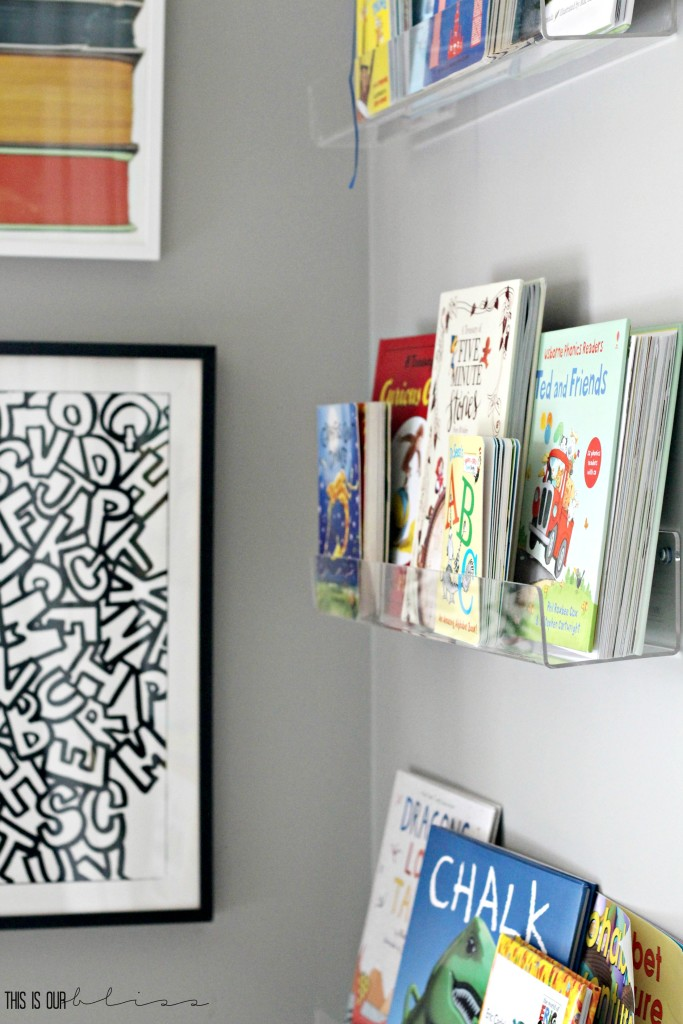 bright-bold-graphic-big-boy-room-book-corner-with-acrylic-shelves-this-is-our-bliss